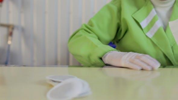 Thumbnail for Woman Prepackages Tea Into Paper Bags, Tea Factory
