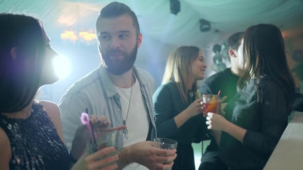 Thumbnail for Guy with a Beard Flirts with a Girl near Bar Counter with Cocktails in the Club