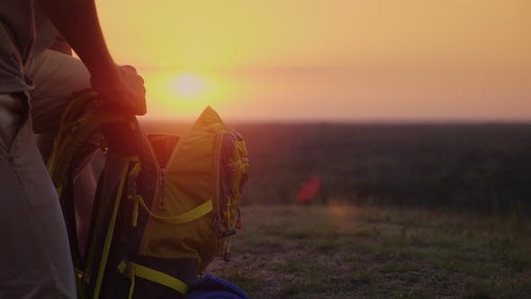 Thumbnail for Collect Things on the Journey. The Man Puts Things in a Hike, Puts Them in a Backpack. At Sunset