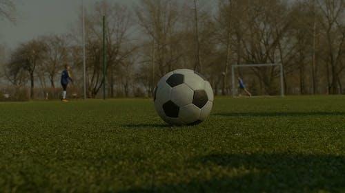 Footballer Kicking Soccer Ball During Free Kick