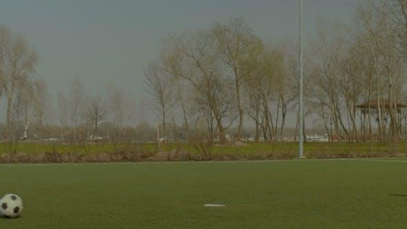 Thumbnail for Soccer Striker Shooting on Goal During Training