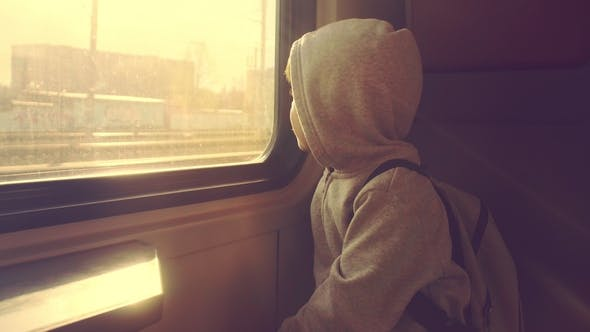 Thumbnail for A Boy Is Riding in a Train Looking Out the Window