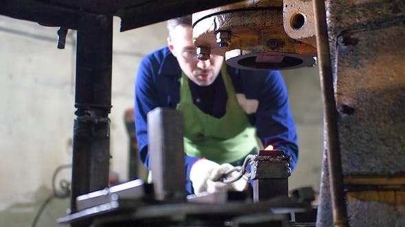 Thumbnail for Making the Knife Out of Metal at the Forge. Man Using Pneumatic Hammer To Shape Hot Metal.
