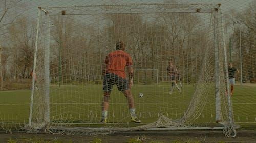 Striker Scoring a Goal After Penalty Kick