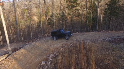 Aerial of Jeep Parked in Wilderness