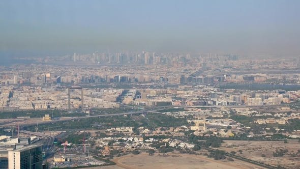 Cover Image for High Panorama of Modern City in Sunny Day, Dubai and Sharjah From Burj Khalifa