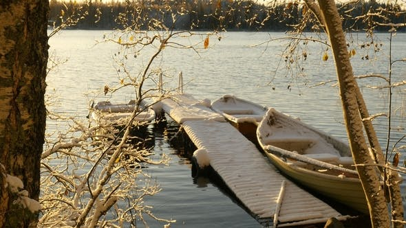 Thumbnail for Snowy Boats Docked on Winter Lake