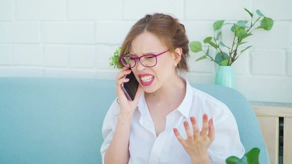 Thumbnail for the Girl Is Talking on the Phone. Quarrels, Swears and Begins To Cry