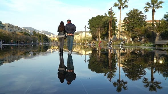 Thumbnail for Unknown Young Couple Walking in Central Nice on Promenade Du Paillon Fountain