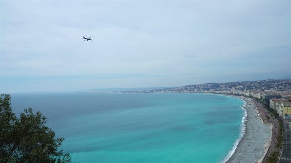 Thumbnail for Plane Flying over the Bay of Angels in Nice at Provence, Cote D'azur, France