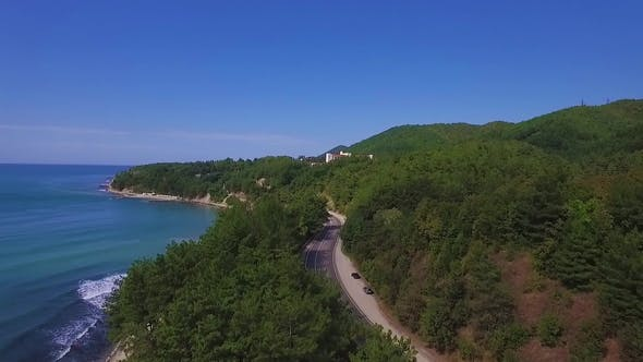 Thumbnail for Video From the Coast. A Road Passes Along the Shore. Montains and Foresst on