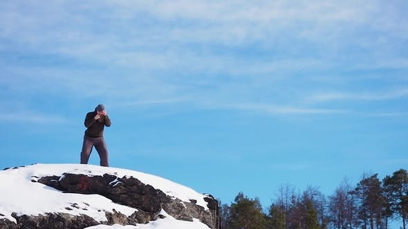 Cover Image for Boxer Trains Atop a Mountain in the Forest in Winter