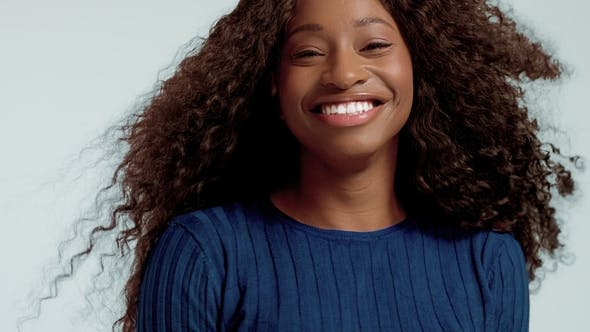 Thumbnail for Beauty Black Mixed Race African American Woman with Long Curly Hair and Perfect Smile