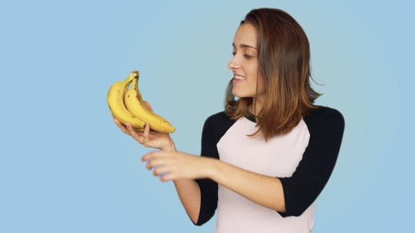 Thumbnail for Pretty Smiling Woman Holds Bunch of Bananas