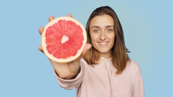 Thumbnail for Cute Happy Smiling Woman Holds Pink Grapefruit