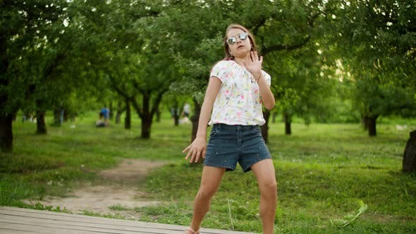 Thumbnail for Funny Girl Dancing Outdoors. Concentrated Teen Girl Making Rhythmical Movements.