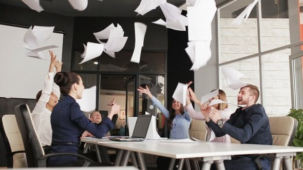 Thumbnail for Group of Business People Throwing Documents in Air