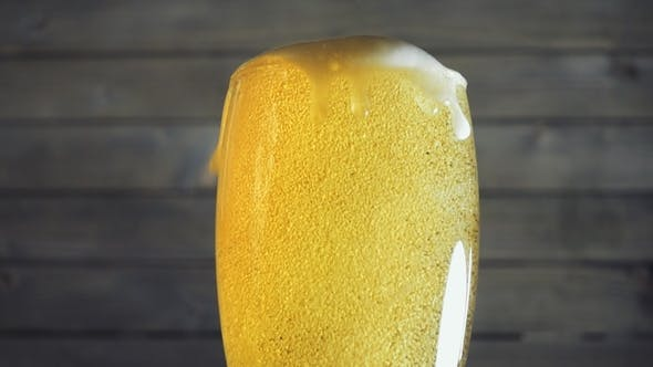 Thumbnail for Beer Poured in Glass on Wood Background.
