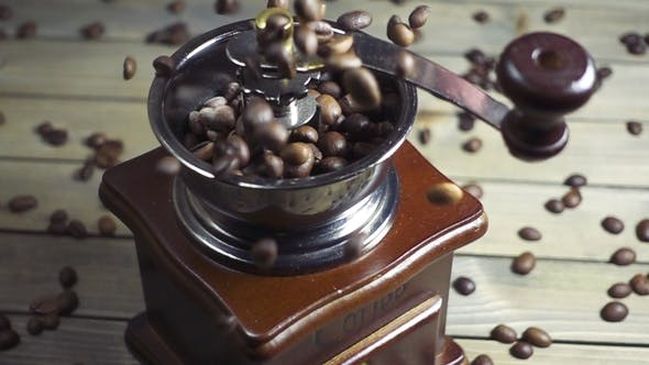 Thumbnail for Pouring Coffee Beans Into Wooden Vintage Grinder,