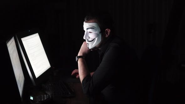 Thumbnail for The Hacker in the Mask Hacks the Program. the Digital Extortion Gets Access To Other People's