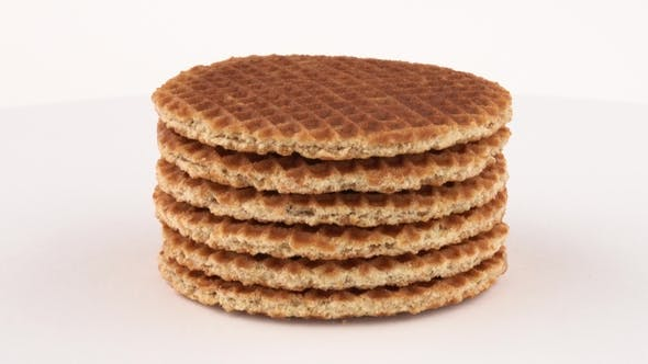Cover Image for Stroopwafel (Dutch Wafels) Cookies Rotating on Turn Table. Isolated on White Background.