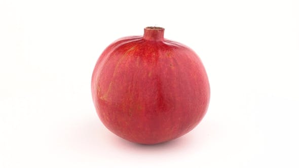 Thumbnail for Whole Pomegranate Fruit Rotating on Turn Table. Isolated on White Background. Loopable.