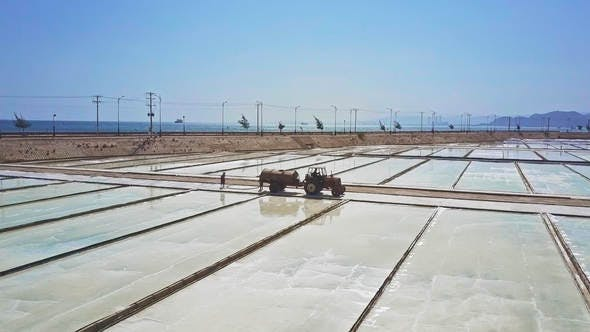 Thumbnail for Tractor with Cistern Drives among Vast Salt Fields