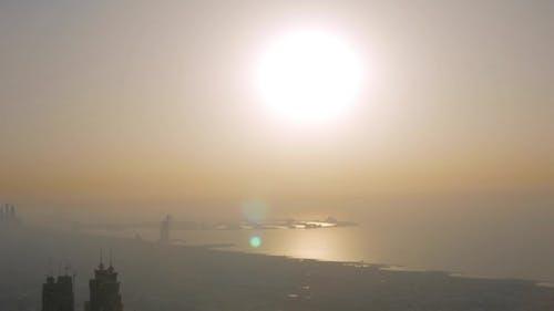 Coastline of Dubai in Sunset Time with Smog and Smoke
