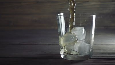Whisky Is Poured Into Glass in