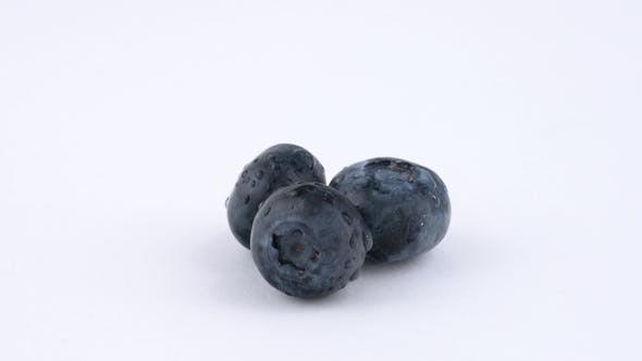 Thumbnail for Three Blueberries Berries Quickly Rotates on White Background. Isolated. Loopable.