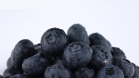Thumbnail for Extreme  of Fresh Blueberries Pile Slowly Rotating on a White Background. Isolated. .