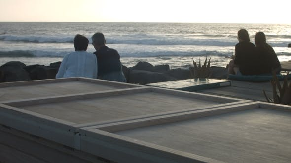 Thumbnail for Two Couples, Young and Middle-Aged on the Beach