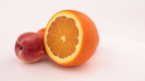 Thumbnail for Fresh and Juicy Orange Fruit, Mandarine and Nectarine Rotating on the Turntable. Isolated on White