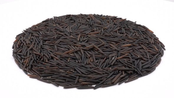 Thumbnail for Circle Shaped Heap of Raw Wild / Black Rice Rotating. Isolated on White. Loopable.  . Angled View.
