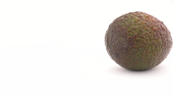 Thumbnail for Camera Is Coming To Slowly Rotating Avocado, Isolated on White Background.  .