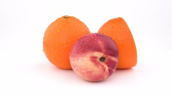 Thumbnail for Juicy Orange Fruit, Mandarine and Nectarine with Water Drops Rotating on White Background. Isolated