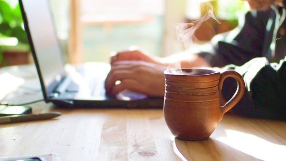 Thumbnail for Hot Tea Near a Man Using Laptop