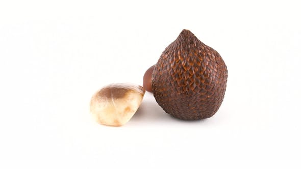 Thumbnail for of One Salak Fruit, Cleaned Part and Pip Rotating on the Turntable. Isolated on White. . Loopable.