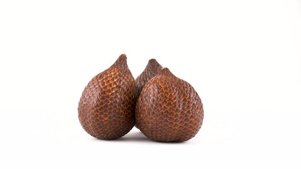 Thumbnail for of Three Salak Fruit Rotating on the Turntable. Isolated on White. Loopable.