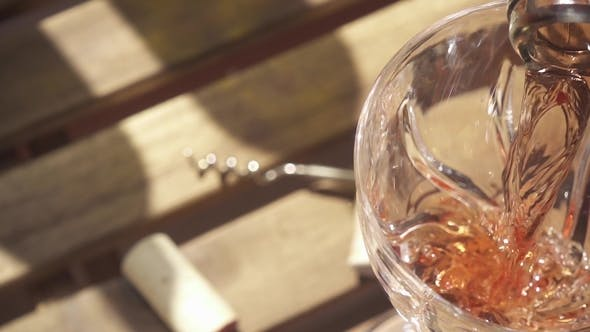 Thumbnail for the Wine From the Bottle Neck Flows Into the Glass on the Table