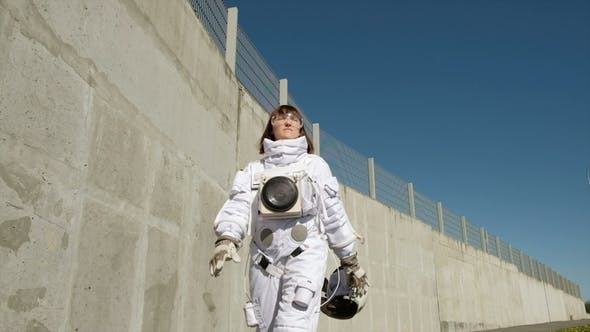 Thumbnail for Female Astronaut Steps Forward. Fantastic Spacesuit. Exploration of Outer Space.