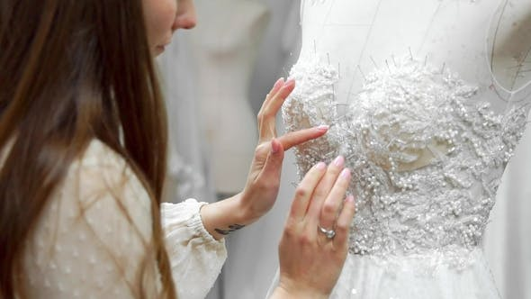 Thumbnail for Girl Creating a Wedding Dress by Exclusive Order Sewing Fabrics and Rhinestones