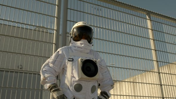 Astronauts Spaceman at the Space Station Looks Into the Sky. Camera Is Spinning Around