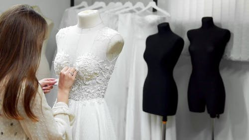 Girl Creating a Wedding Dress by Exclusive Order Sewing Fabrics and Rhinestones