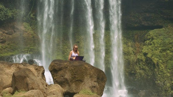 Thumbnail for Camera Moves to Lady with Laptop by Foamy WaterFall