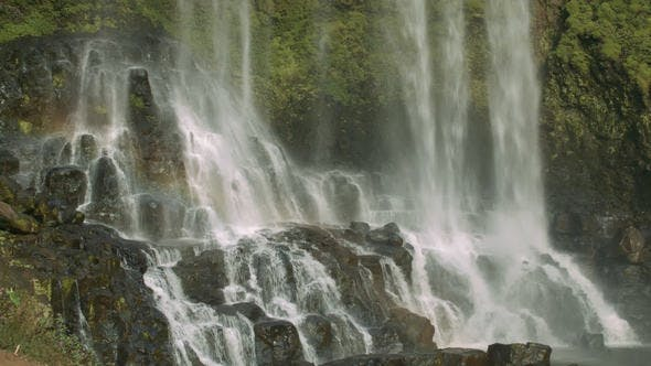 Thumbnail for Rainbow above Beautiful Waterfall with Steep Rocks