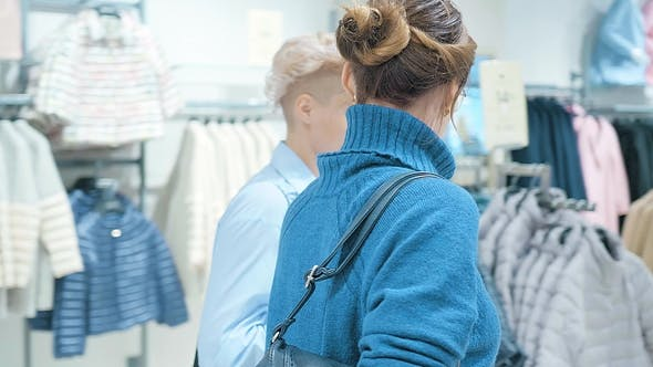 Thumbnail for Two Women at a Boutique Choosing a Dress