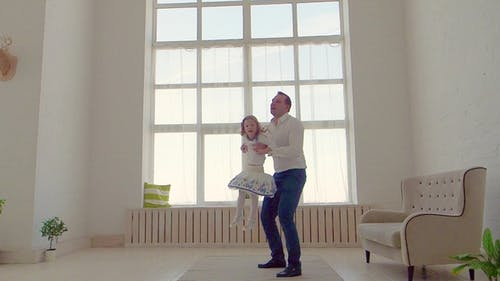 Happy Family Idyll Little Child Daughter Jump On Father Arms