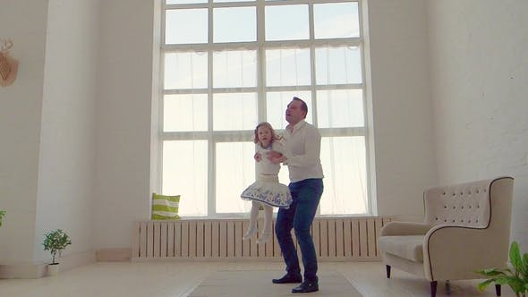 Thumbnail for Happy Family Idyll Little Child Daughter Jump On Father Arms