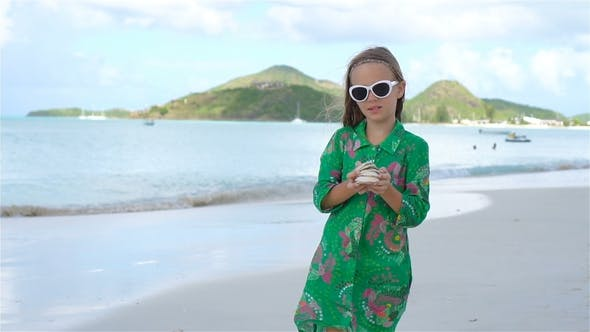 Thumbnail for Cute Little Girl in Hat at Beach During Caribbean Vacation